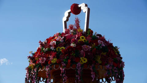 gorgeous baskets full of flowers in wind.clouds in blue sky Footage
