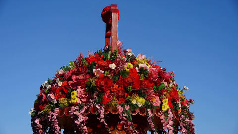Baskets full of flowers.Beijing Tiananmen Square & national emblem of China Footage