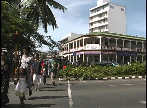 Pedestrians walking near tall buildings on Main Street of... Stock Video Footage