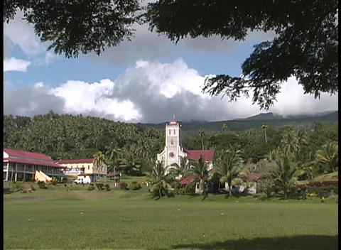 A small village sitting near the hills and trees of an... Stock Video Footage