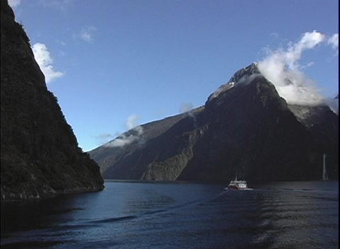 Point-of-view shot from a boat floating in a fjord at Milford Sound, New Zealand Footage