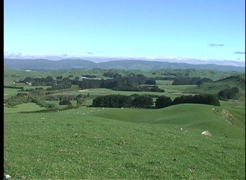 A scenic view of rolling hills and green fields in New... Stock Video Footage