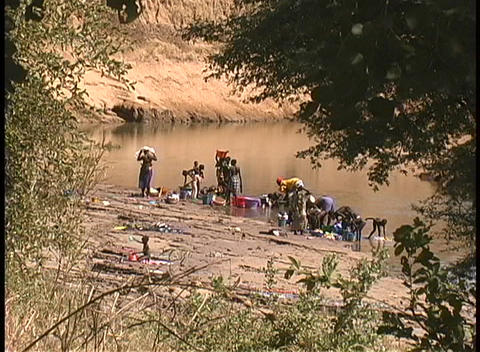 Women wash clothes in the Niger River in West Africa Footage