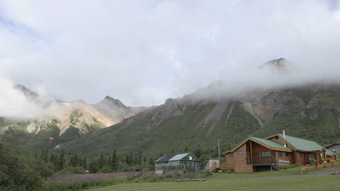 Time lapse of clouds blowing over Sheep Mountain Lodge,... Stock Video Footage