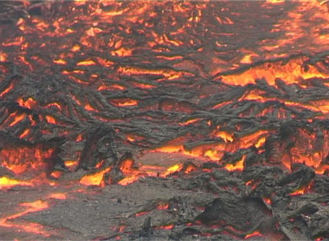 A crust forms on flowing lava Stock Video Footage