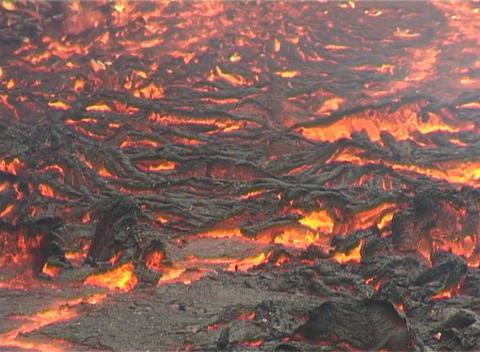 A Crust Forms On Flowing Lava stock footage