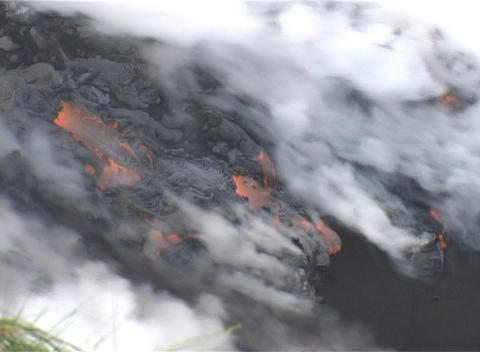 Smoke, ash and steam rise from a lava flow after a... Stock Video Footage