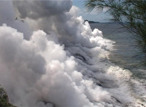 Lava flows into the ocean in a remarkable display of the... Stock Video Footage