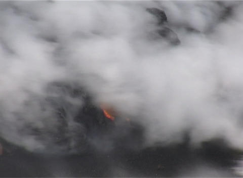 Ocean waves crash against a lava flow on a South Pacific... Stock Video Footage