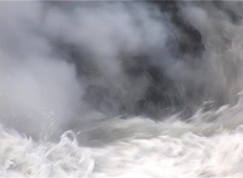 Ocean waves crash against a lava flow on a South Pacific island causing huge clouds of steam Footage