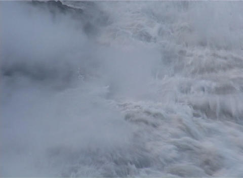 Ocean waves crash onto a lava flow as an island is formed... Stock Video Footage