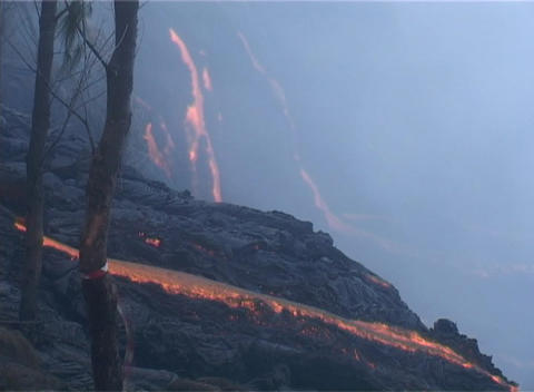 Lava flows over cliffs on Reunion Island Stock Video Footage