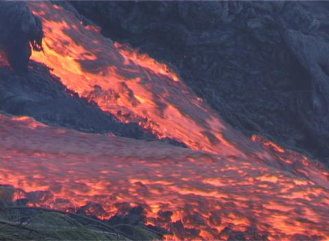 Red hot lava flows down the slopes of a volcano Stock Video Footage