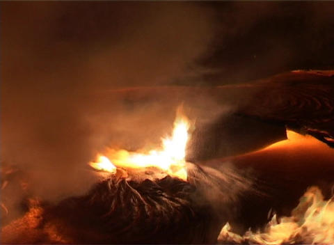 Fires, smoke, and molten lava create a surrealistic... Stock Video Footage