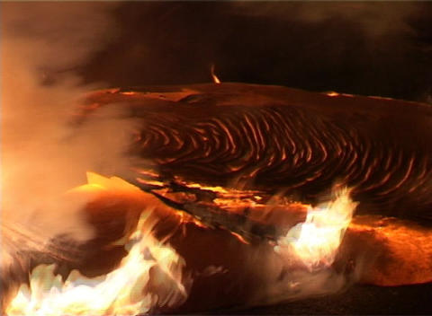 Fires, smoke, and molten lava create a surrealistic landscape after a volcanic eruption Footage