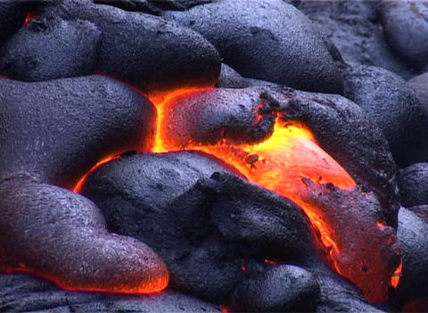 Cooling crust shows fiery hot molten lava underneath Stock Video Footage