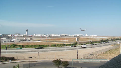 A wide shot of planes take off and taxi at Los Angeles International Airport Footage