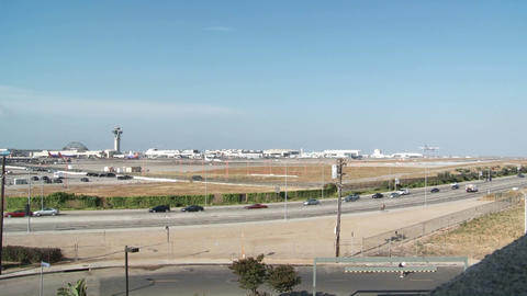 A wide shot of planes take off and taxi at Los Angeles... Stock Video Footage