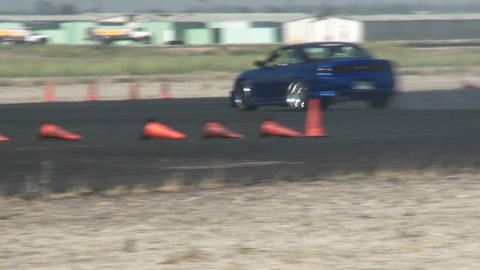 A blue car squeals its tires as it is skillfully guided... Stock Video Footage