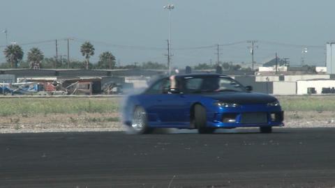 A blue car glides through a drifting course at Camarillo... Stock Video Footage