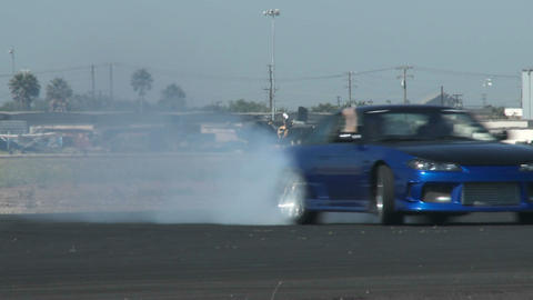 A blue car glides through a drifting course at Camarillo Airport in Camarillo California Footage