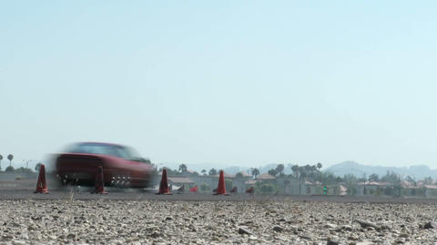 low shot of a red car as it smokes its tires through a... Stock Video Footage
