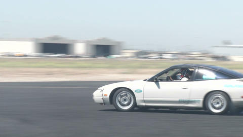 A driver does figure eights as it practices drifting at Camarillo Airport Footage