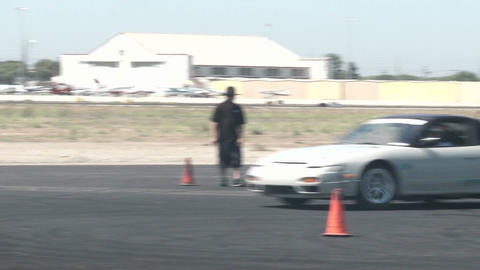 A driver does figure eights as it practices drifting at... Stock Video Footage