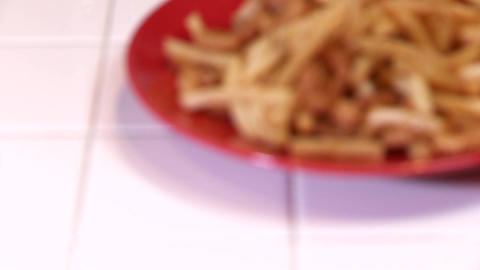 A rack focus of a plate of fries and onion rings Stock Video Footage