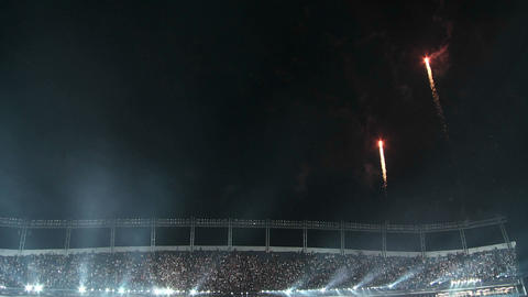 People clap and cheer as fireworks explode overhead... Stock Video Footage