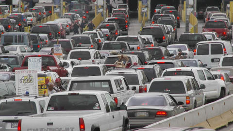 Cars wait to cross back into the United States from Tijuana Mexico Footage