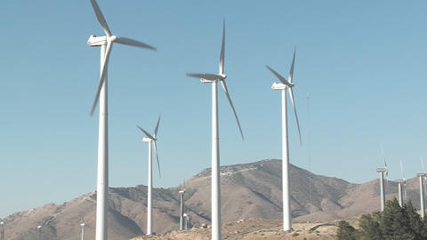 Windmills are turned by the wind in Tehachapi California Footage