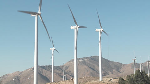 Windmills are turned by the wind in Tehachapi California Stock Video Footage