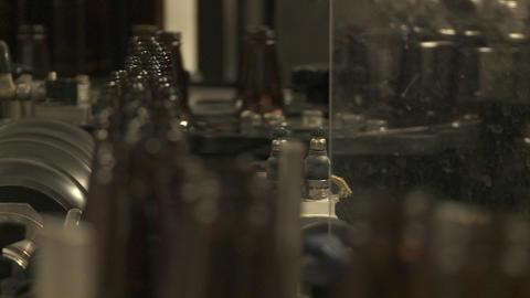 Bottles zip along a conveyor belt in a bottling plant Stock Video Footage