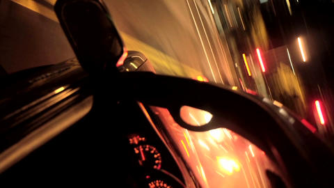 A tilted POV shot of driving through a city at night in... Stock Video Footage