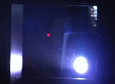 Light from a projector reflects off of dust particles Stock Video Footage