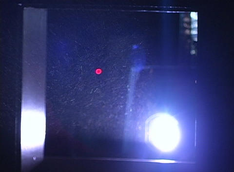 Light from a projector reflects off of dust particles Footage
