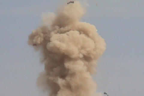 An explosion sends dirt and metal shards into the air in... Stock Video Footage