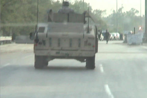A US army tank rolls through the streets of Baghdad Iraq Stock Video Footage
