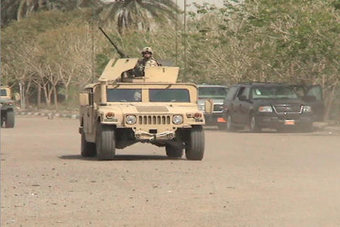 US Army armored Humvees head down a road in Iraq Stock Video Footage