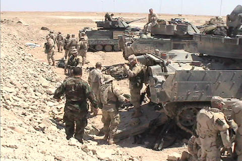 The US Army mills around a lineup of tanks in the Iraqi... Stock Video Footage