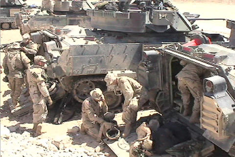 The US Army mills around a lineup of tanks in the Iraqi desert Footage
