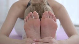 Attractive Japanese young woman practicing Yoga in an airy room Footage