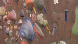 Panning shot of bouldering wall in a gym Footage