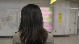 Slow motion footage of Japanese young woman getting off a train downtown Tokyo Footage