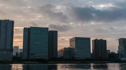 Time-lapse panning footage of cloudy sky over Tokyo cityscape at sunset, Tokyo,  Footage