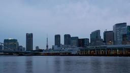 Day to night time-lapse footage of Tokyo tower and cityscape from Sumida river,  Footage