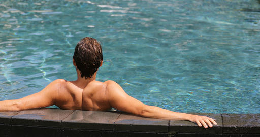 Swimming pool resort relaxation - relaxing man enjoying travel Live Action