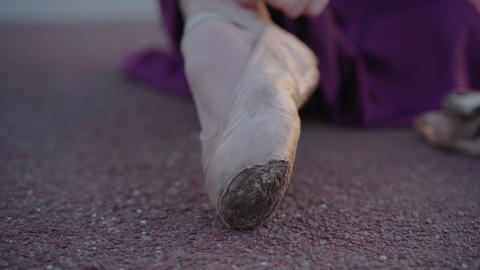 Extreme close-up of female foot in pointes. Camera moves along leg of Caucasian Live Action