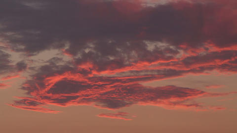 Dramatic red and orange sky and clouds abstract background. Red-orange clouds on sunset sky. Warm Live Action